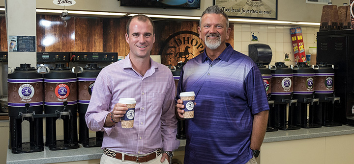 Photo of Landhope Farms' managers grabbing a cup of coffee.